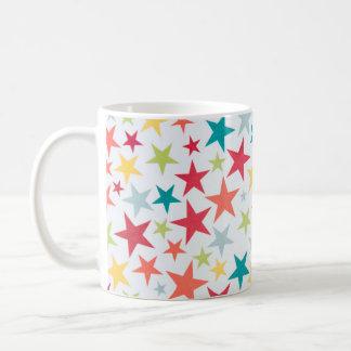 Caneca de café pequena colorida das estrelas