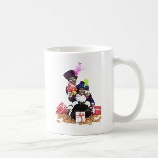 Caneca De Café Piet preto com presentes e doces dos gingernuts