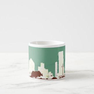 Caneca de café verde do café da cidade