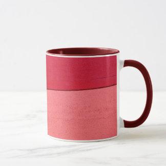 Caneca de café vermelha & cor-de-rosa