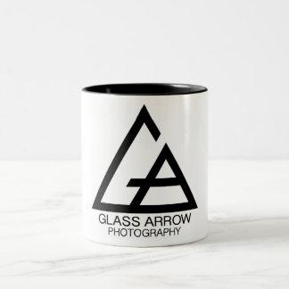 Caneca de vidro da fotografia da seta