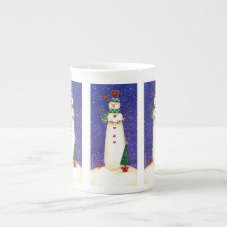 Caneca do boneco de neve do Natal