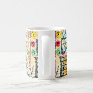 Caneca do café ou do chá com caixa, espelho e
