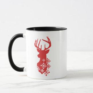 Caneca do Natal com os flocos de neve na rena