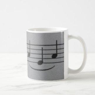 Caneca do sorriso das notas musicais