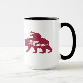 Caneca dobro do logotipo do urso e do texugo