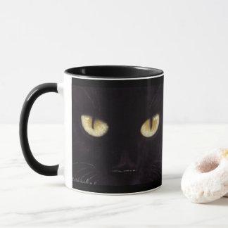 Caneca dos olhos de gato preto