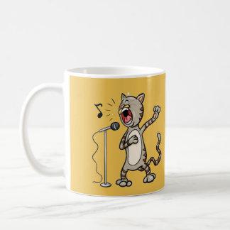 Caneca engraçada/amarelo do gato do canto