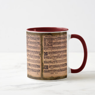 Caneca gregoriana do bebendo da folha de música do