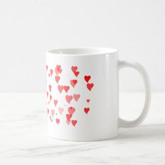 Caneca minúscula doce do amor dos corações