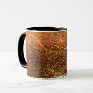 Caneca O ouro e o bronze chapearam a textura com um patte