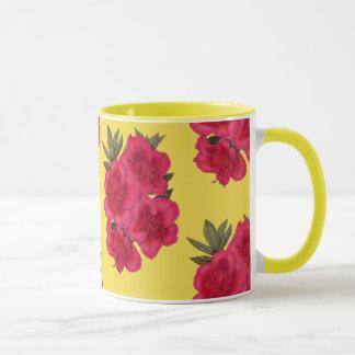 Caneca vermelha e amarela da flor da azálea