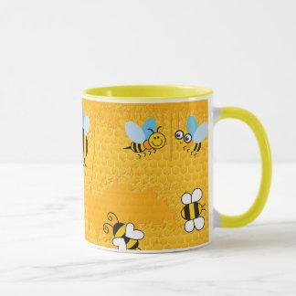 Canecas da campainha da abelha do favo de mel e