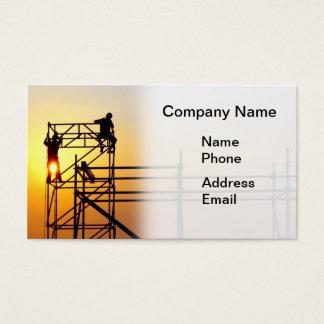 Canteiro de obras com os trabalhadores no por do cartão de visitas