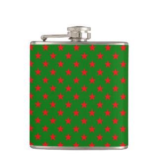 Cantil Estrelas vermelhas no fundo do verde do Natal