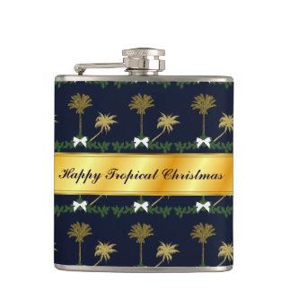 Cantil Natal tropical do azul e do ouro com palmeiras