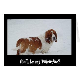 Cão de Basset na neve no cartão do dia dos