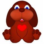 Cão de filhote de cachorro com coração vermelho escultura foto