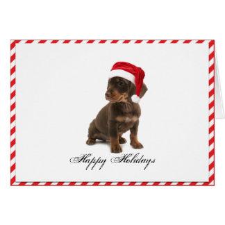 Cão de filhote de cachorro de Daschund no cartão