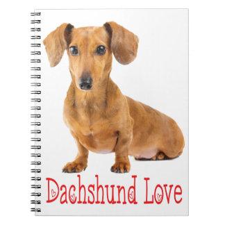 Cão de filhote de cachorro de Tan do amor do Cadernos