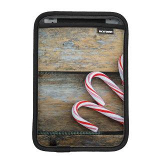 Capa iPad Mini Madeira rústica com os bastões de doces do Natal