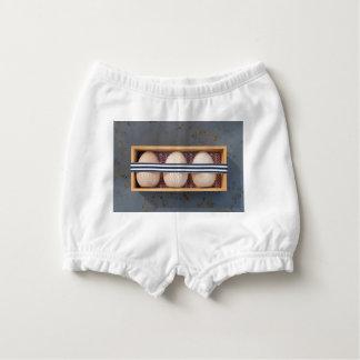 Capa Para Fralda Ovos de madeira em uma caixa