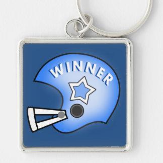 capacete de futebol azul com o chaveiro do