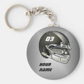 Capacete de futebol preto e de prata chaveiro
