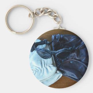 Capacete, óculos de proteção e luvas do vôo chaveiro