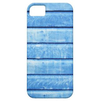 Capas de iphone retros com fundo de madeira azul