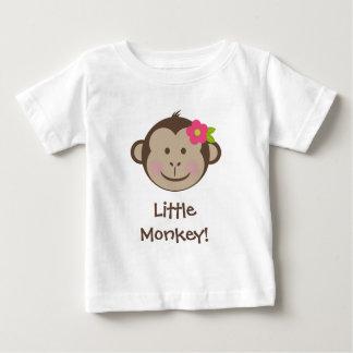 Cara da menina do macaco com camisa da flor