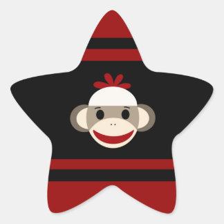 Cara de sorriso bonito do macaco da peúga no preto adesivo estrela