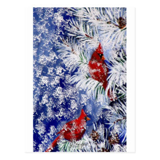 Cardeais na neve cartão postal