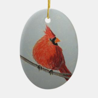 Cardeal vermelho no ramo no ornamento dos Pastels