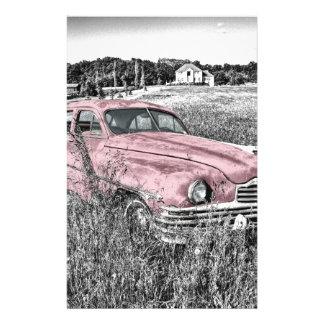 Carro cor-de-rosa clássico do vintage papelaria