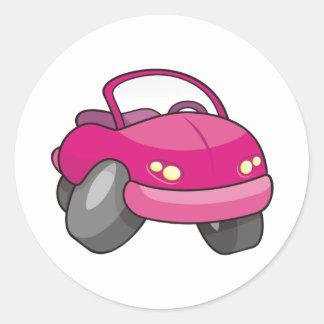 Carro cor-de-rosa dos desenhos animados adesivos em formato redondos