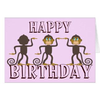 Cartão A dança feliz monkeys o aniversário cor-de-rosa