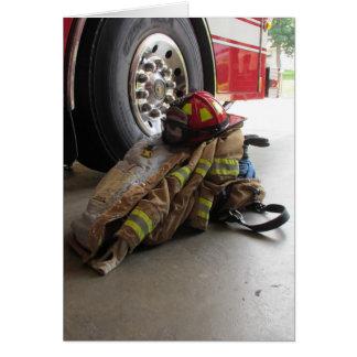 Cartão A engrenagem e o caminhão do bombeiro