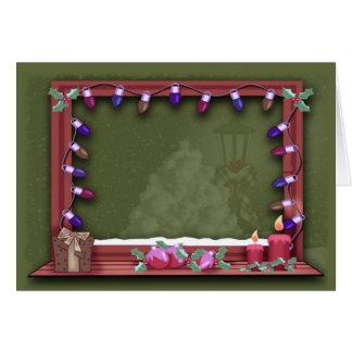 Cartão A janela do Natal do inverno ilumina a inserção da