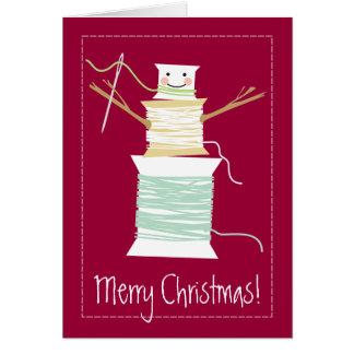 Cartão A linha Sewing enrola o feriado do Natal do boneco