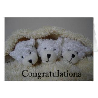 Cartão a objectiva tripla carrega parabéns