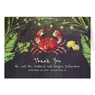 Cartão A palma da praia do caranguejo ilumina o obrigado