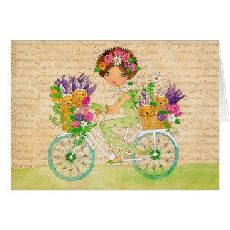 Cartão A páscoa floresce a bicicleta com filhotes de