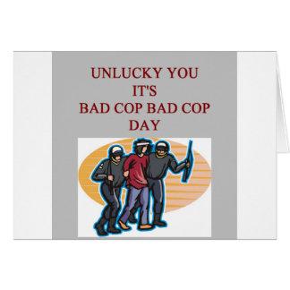 Cartão a polícia má da bobina da boa bobina graceja