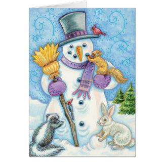 Cartão Animais bonitos do Natal que constroem um boneco