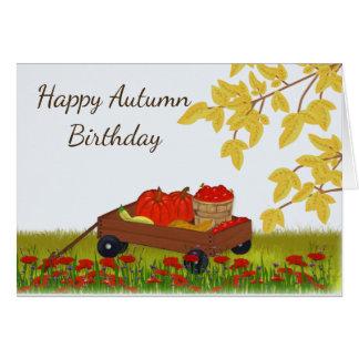 Cartão Aniversário, abóboras e maçãs do outono em um
