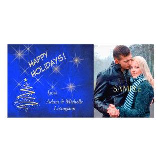 Cartão Árvore de Natal da estrela do ouro no azul