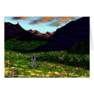 Cartão asno que olha fixamente em montanhas