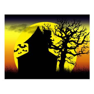 Cartão assombrado do por do sol da casa