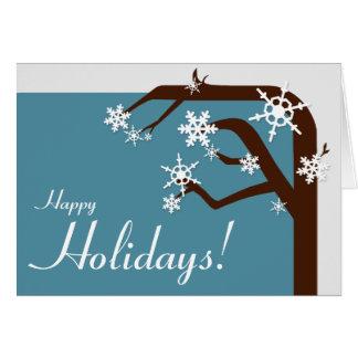 Cartão azul do feriado do floco de neve da árvore